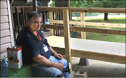 Lee Shouse rests beside a new entry ramp built in Henryetta this summer, and Catee Shouse plans gardening work on a 2014 project in Norman. Vinita UMC is this family's home church.